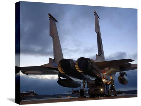 A Weapons Loading Team Attach An AIM-7M Sparrow Missile On An F-15 Eagle-Stocktrek Images-Stretched Canvas Print
