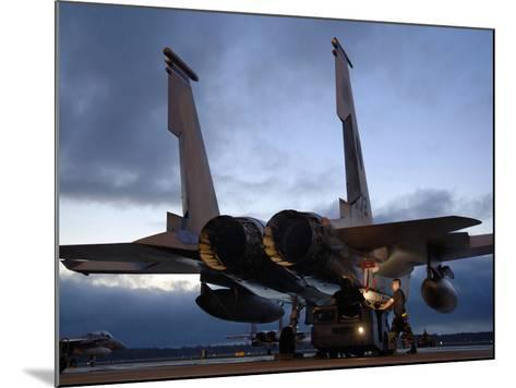 A Weapons Loading Team Attach An AIM-7M Sparrow Missile On An F-15 Eagle-Stocktrek Images-Mounted Photographic Print