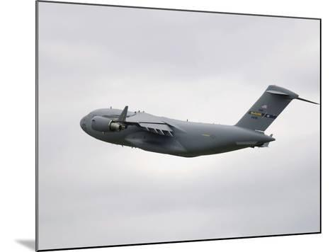 A C-17 Globemaster III in Flight-Stocktrek Images-Mounted Photographic Print