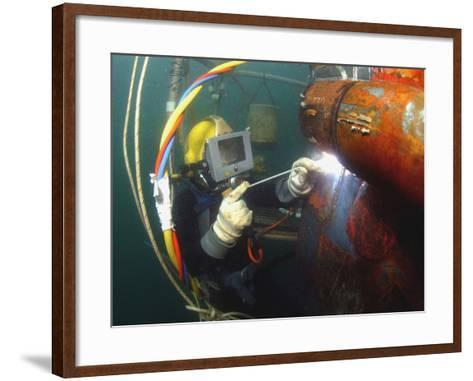 U.S. Navy Diver Welds a Repair Patch On the Submerged Bow of the USS Ogden-Stocktrek Images-Framed Art Print