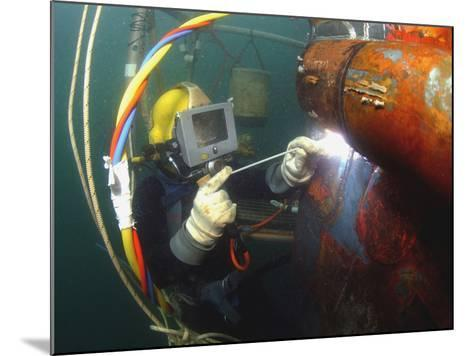 U.S. Navy Diver Welds a Repair Patch On the Submerged Bow of the USS Ogden-Stocktrek Images-Mounted Photographic Print
