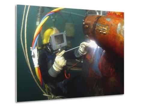 U.S. Navy Diver Welds a Repair Patch On the Submerged Bow of the USS Ogden-Stocktrek Images-Metal Print