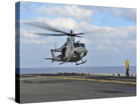 Aviation Boatswain's Mate Directs a UH-1Y Venom-Stocktrek Images-Stretched Canvas Print