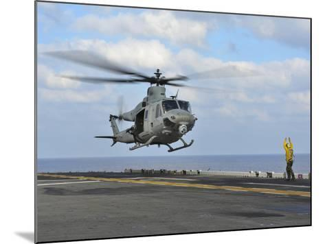 Aviation Boatswain's Mate Directs a UH-1Y Venom-Stocktrek Images-Mounted Photographic Print