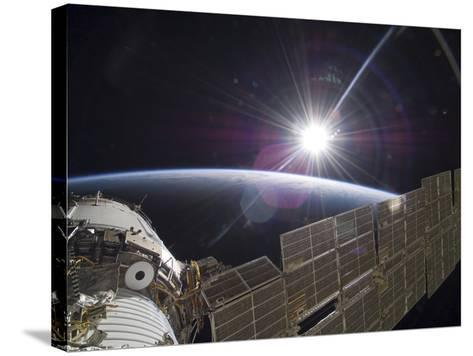 The International Space Station Backdropped by the Bright Sun Over Earth's Horizon-Stocktrek Images-Stretched Canvas Print