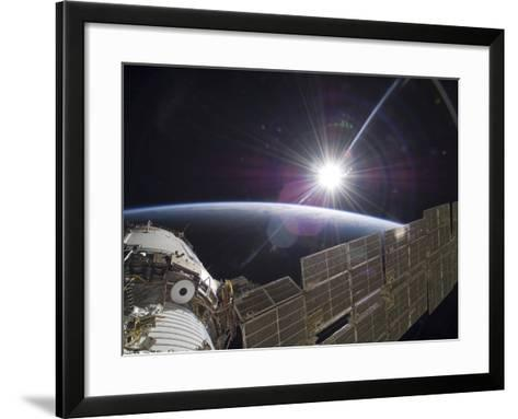 The International Space Station Backdropped by the Bright Sun Over Earth's Horizon-Stocktrek Images-Framed Art Print