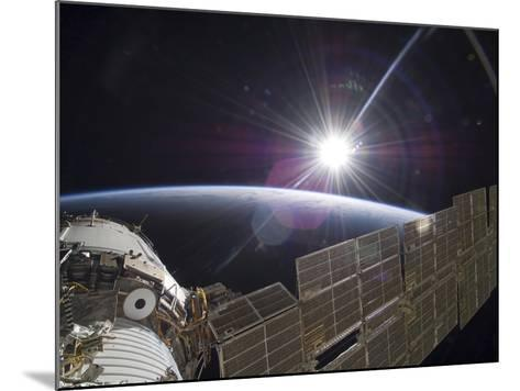 The International Space Station Backdropped by the Bright Sun Over Earth's Horizon-Stocktrek Images-Mounted Photographic Print
