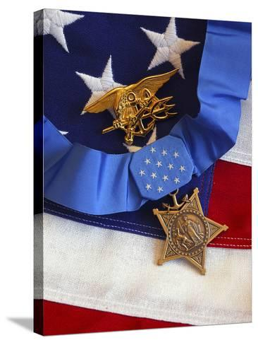 The Medal of Honor Rests On a Flag Beside a SEAL Trident-Stocktrek Images-Stretched Canvas Print