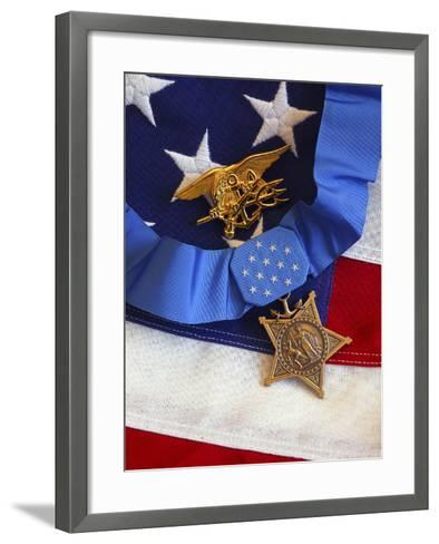 The Medal of Honor Rests On a Flag Beside a SEAL Trident-Stocktrek Images-Framed Art Print