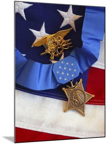 The Medal of Honor Rests On a Flag Beside a SEAL Trident-Stocktrek Images-Mounted Photographic Print