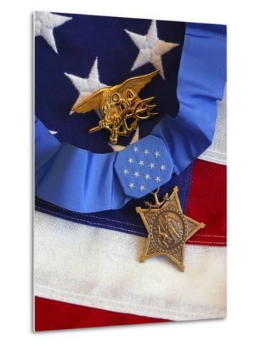The Medal of Honor Rests On a Flag Beside a SEAL Trident-Stocktrek Images-Metal Print