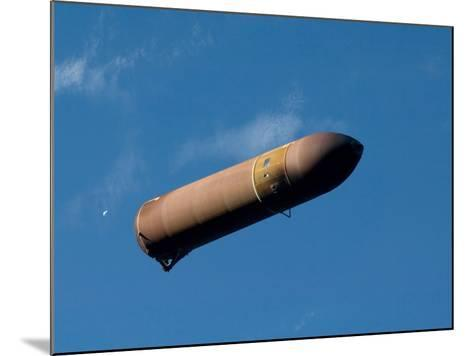 An External Fuel Tank Backdropped by a Blue And White Part of Earth-Stocktrek Images-Mounted Photographic Print