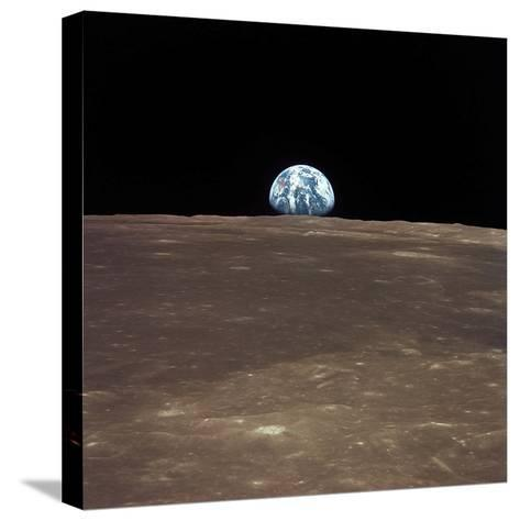 Earth Rising Above the Moon's Horizon-Stocktrek Images-Stretched Canvas Print