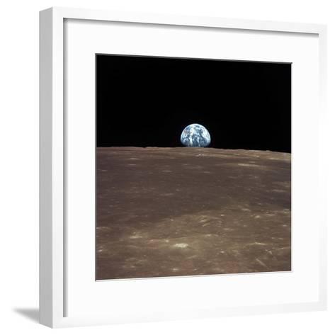 Earth Rising Above the Moon's Horizon-Stocktrek Images-Framed Art Print