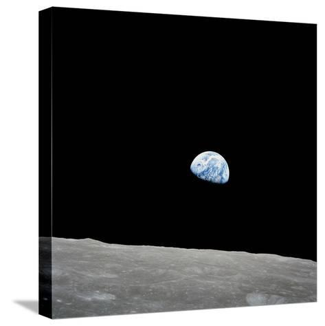 Earth Rising Above the Lunar Horizon-Stocktrek Images-Stretched Canvas Print