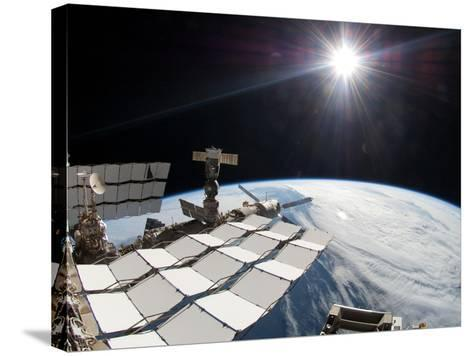 The Bright Sun, a Portion of the International Space Station And Earth's Horizon-Stocktrek Images-Stretched Canvas Print