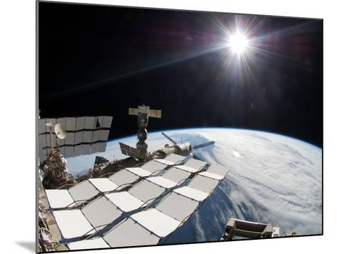 The Bright Sun, a Portion of the International Space Station And Earth's Horizon-Stocktrek Images-Mounted Photographic Print
