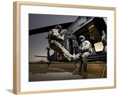 U.S. Army Crew Strapped Into the Medevac Hoist of a UH-60L Black Hawk-Stocktrek Images-Framed Art Print