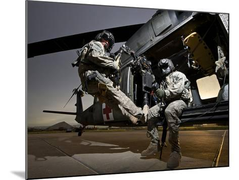 U.S. Army Crew Strapped Into the Medevac Hoist of a UH-60L Black Hawk-Stocktrek Images-Mounted Photographic Print