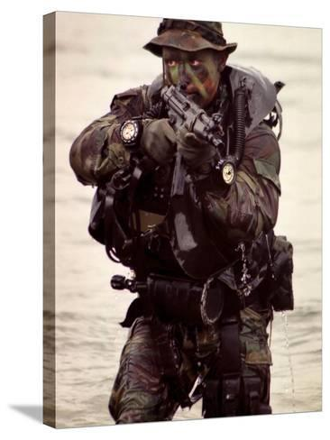 A Navy SEAL Exits the Water Armed And Alert For Action-Stocktrek Images-Stretched Canvas Print