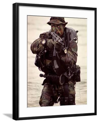 A Navy SEAL Exits the Water Armed And Alert For Action-Stocktrek Images-Framed Art Print
