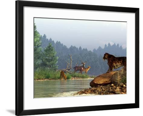 A Saber-toothed Cat Looks Across a River at a Family of Deer-Stocktrek Images-Framed Art Print
