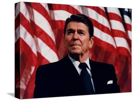Digitally Restored Vector Photo of President Ronald Reagan in Front of American Flag-Stocktrek Images-Stretched Canvas Print