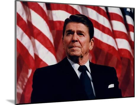 Digitally Restored Vector Photo of President Ronald Reagan in Front of American Flag-Stocktrek Images-Mounted Photographic Print