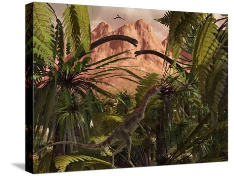 A Compsognathus Treads Carefully Through a Jurassic Jungle-Stocktrek Images-Stretched Canvas Print