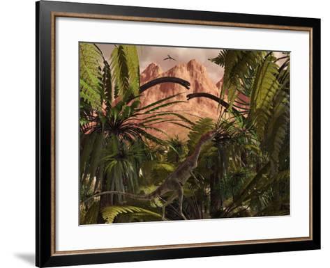 A Compsognathus Treads Carefully Through a Jurassic Jungle-Stocktrek Images-Framed Art Print