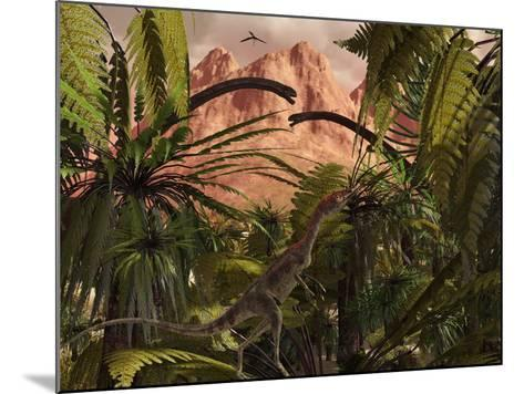 A Compsognathus Treads Carefully Through a Jurassic Jungle-Stocktrek Images-Mounted Photographic Print