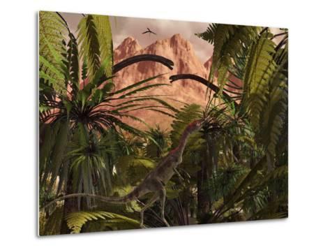 A Compsognathus Treads Carefully Through a Jurassic Jungle-Stocktrek Images-Metal Print