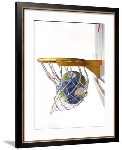 3D Rendering of Planet Earth Falling Into a Basketball Hoop-Stocktrek Images-Framed Art Print
