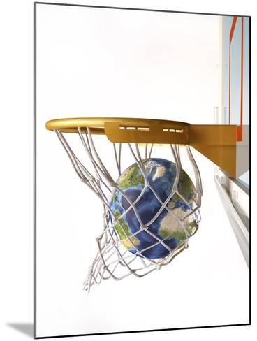 3D Rendering of Planet Earth Falling Into a Basketball Hoop-Stocktrek Images-Mounted Photographic Print