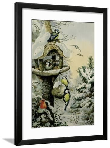 Winter Bird Table with Blue Tits, Great Tits, House Sparrows and a Robin-Carl Donner-Framed Art Print