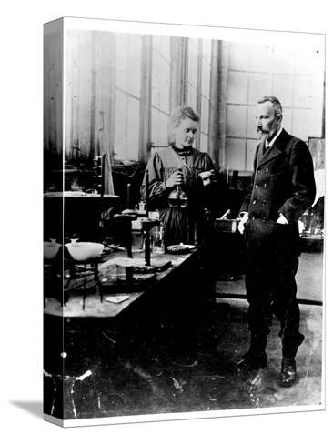 Pierre (1859-1906) and Marie Curie (1867-1934) in their Laboratory, c.1900-Valerian Gribayedoff-Stretched Canvas Print