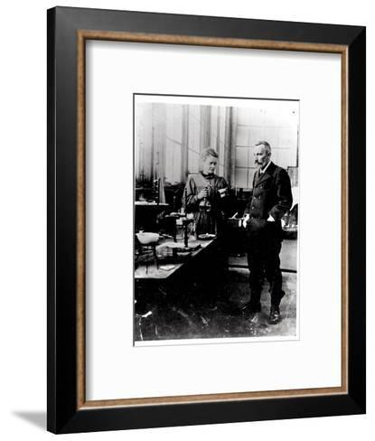 Pierre (1859-1906) and Marie Curie (1867-1934) in their Laboratory, c.1900-Valerian Gribayedoff-Framed Art Print