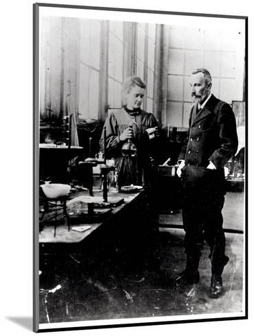 Pierre (1859-1906) and Marie Curie (1867-1934) in their Laboratory, c.1900-Valerian Gribayedoff-Mounted Photographic Print