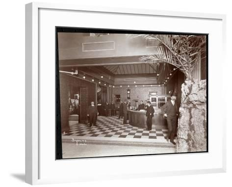 The Lobby and Registration Desk at the Hotel Victoria, 1900 or 1901-Byron Company-Framed Art Print