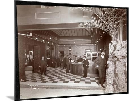The Lobby and Registration Desk at the Hotel Victoria, 1900 or 1901-Byron Company-Mounted Giclee Print