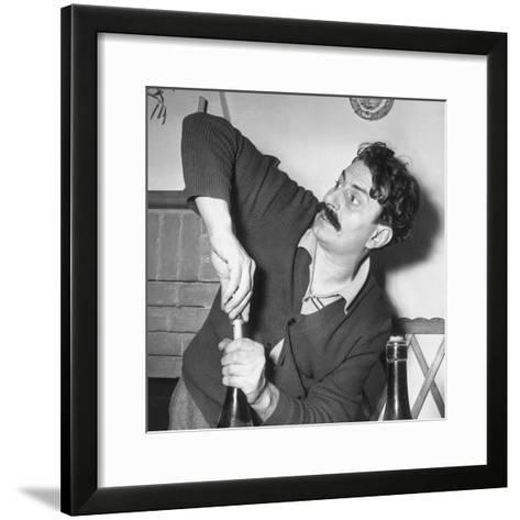 Giovanni Guareschi in His Wine Cellar, 1st December 1950--Framed Art Print
