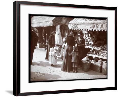 View of Women with Children Shopping at a Fruit and Vegetable Stand at 266 7th Avenue, New York,…-Byron Company-Framed Art Print