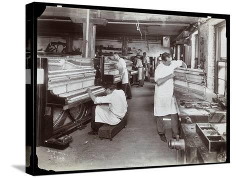 Men Working in the Hardman, Peck and Co. Piano Factory, New York, 1907-Byron Company-Stretched Canvas Print
