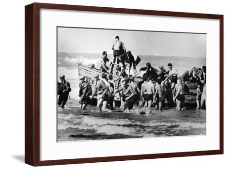 Illegal Jewish Immigrants Helped Ashore When Arriving Unseen by the British Navy on the…--Framed Art Print