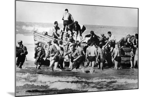 Illegal Jewish Immigrants Helped Ashore When Arriving Unseen by the British Navy on the…--Mounted Photographic Print