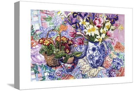 Daffodils, Tulips and Iris in a Jacobean Blue and White Jug with Sanderson Fabric and Primroses,?-Joan Thewsey-Stretched Canvas Print
