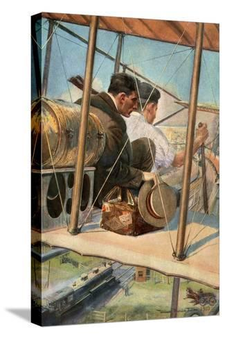 Biplane with Pilot and Passenger Flying Over a Locomotive, 1910--Stretched Canvas Print