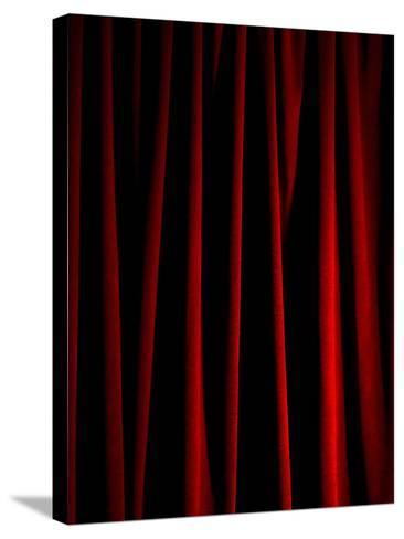 Rich Red Curtain-Graeme Montgomery-Stretched Canvas Print