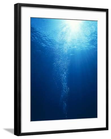 Bright Light Shooting To Surface of Deep Blue Sea with Trail of Bubbles--Framed Art Print