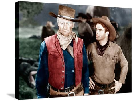 RED RIVER, from left: John Wayne, Montgomery Clift, 1948--Stretched Canvas Print